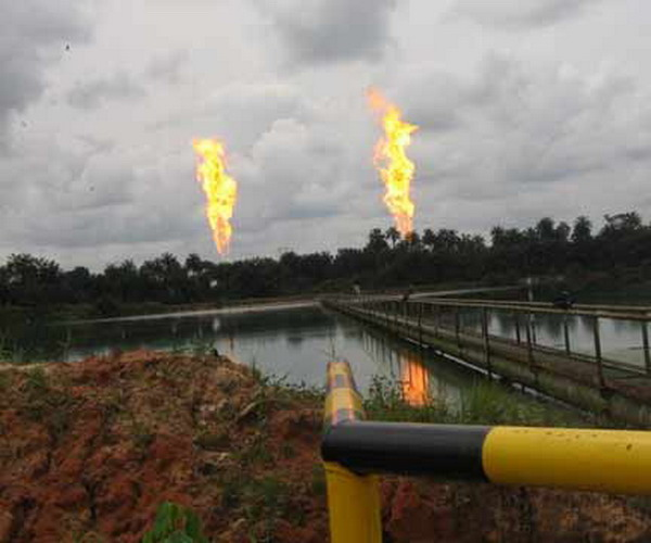 Why are there Plumes of Burning Gas in that Open Field?